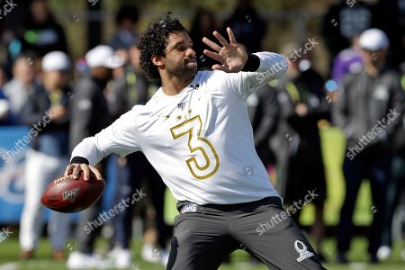 NFC quarterback Russell Wilson, of the Seattle Seahawks, throws a pass during a practice for the NFL Pro Bowl football game, in Kissimmee, Fla
