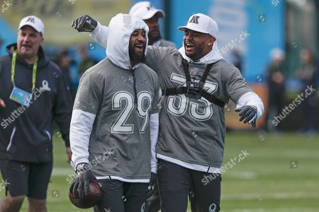 Earl Thomas, Jamal Adams. AFC free safety Earl Thomas (29) of the Baltimore Ravens jokes with safety Jamal Adams of the New York Jets (33) during a practice for NFL Pro Bowl football game, in Kissimmee, Fla