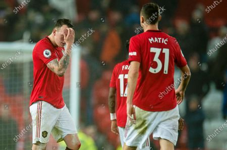 Manchester United's Phil Jones (L) reacts after the English Premier League soccer match between Manchester United and Burnley FC at Old Trafford in Manchester, Britain, 22 January 2020.