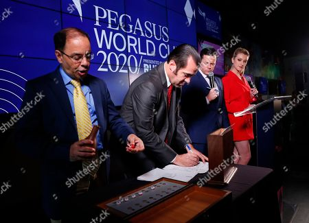 Eric Friedman, Michael Costanzo, Acacia Courtney, Jason Blewitt, Irad Ortiz Jr., Bricks and Mortar. Stakes coordinator Eric Friedman, left, draws a number as assistant racing secretary Michael Costanzo, second from left, pulls out a horse's name during the draw for the Pegasus World Cup Horse Race, in Hallandale Beach, Fla. At right are racing analysts Acacia Courtney and Jason Blewitt, second from right, The race will run Saturday, Jan. 25