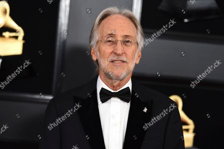 """Then President and CEO of The Recording Academy Neil Portnow at the 61st annual Grammy Awards in Los Angeles. Portnow says a rape allegation against him aired in a complaint against the Recording Academy by his successor is """"false and outrageous."""" Portnow released a statement saying the academy during his tenure had conducted a thorough and independent investigation and he was """"completely exonerated"""