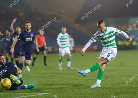 Stock Picture of Leigh Griffiths of Celtic shoots past Alex Bruce of Kilmarnock to score and give Celtic a 2-0 lead.