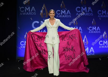 Jennifer Nettles wearing an outfit with wording asking radio stations to play more songs by women at the 53rd annual CMA Awards in Nashville, Tenn. What started as a joke on Twitter about an unwritten rule among country radio stations not to play two female artists in a row prompted outrage by country music stars, but also pledges to give women equal airtime. CMT announced, that they would institute equal airplay for female artists across their two channels. And a country radio station in Ontario, Canada, started an equal play initiative for one week, pledging to split the airplay time 50-50 between men and female voices
