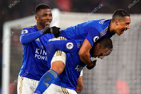 Leicester City's Ricardo Pereira (bottom) celebrates with teammates Youri Tielemans (up) and Kelechi Iheanacho (L) after scoring the 2-0 lead during the English Premier League soccer match between Leicester City and West Ham United at the King Power stadium in Leicester, Britain, 22 January 2020.