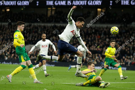 Tottenham's Dele Alli challenges for the ball during the English Premier League soccer match between Tottenham Hotspur and Norwich City at the Tottenham Hotspur Stadium in London, England