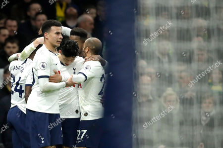 Tottenham's Dele Alli, celebrates his goal with his teammates after scores against Norwich City during the English Premier League soccer match between Tottenham Hotspur and Norwich City at the Tottenham Hotspur Stadium in London, England