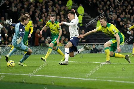Tottenham's Dele Alli scores against Norwich City during the English Premier League soccer match between Tottenham Hotspur and Norwich City at the Tottenham Hotspur Stadium in London, England