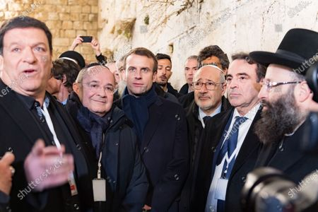 Stock Picture of Emmanuel Macron, Francis Kalifat and Joel Mergui visit the Western Wall, Judaism's holiest prayer site, in Jerusalem's Old City.