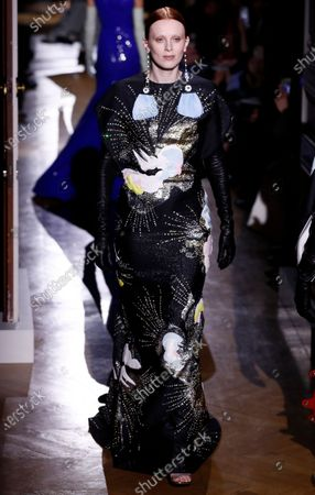 British model Karen Elson presents a creation from the Spring/Summer 2020 Haute Couture collection by Italian designer Pier Paolo Piccioli for Valentino fashion house during the Paris Fashion Week, in Paris, France, 22 January 2020. The presentation of the Haute Couture collections runs from 20 to 23 January 2020.