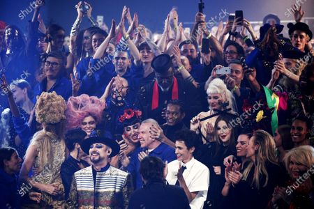 French designer Jean Paul Gaultier (C) is greeted by friends and models, including Rossy de Palma, Boy George, Farida Khelfa, Amanda Lear, Blanca Li, Estelle Lefebure after he presented his last Spring/Summer 2020 Haute Couture collection during the Paris Fashion Week, in Paris, France, 22 January 2020. After 50 years in the fashion industry, Gaultier announced that this Haute Couture show at the Theatre du Chatelet will be his last. The presentation of the Haute Couture collections ends on 23 January 2020.