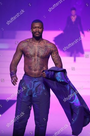 Former soccer player Djibril Cisse wears a creation for the final Jean Paul Gaultier Haute Couture Spring/Summer 2020 fashion collection presented in Paris. Fashion icon Gaultier presented his final couture catwalk collection, the designer's only remaining runway show since putting an end to his ready-to-wear collections in 2014