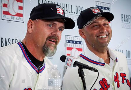 Colorado Rockies outfielder Larry Walker, left, and New York Yankees shortstop Derek Jeter, right, speak during a Baseball Hall of Fame press conference, in New York. Walker and Jeter will both join the 2020 Hall of Fame class