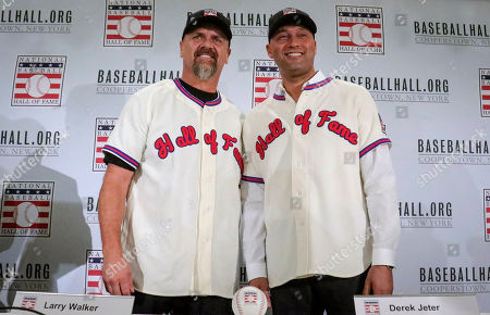 Colorado Rockies outfielder Larry Walker, left, and New York Yankees shortstop Derek Jeter pose after receiving their Baseball Hall of Fame cap and jersey, during a press conference in New York. Jeter and Walker will both join the 2020 Hall of Fame class