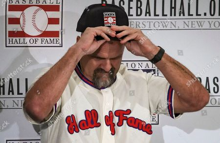 Colorado Rockies outfielder Larry Walker put his cap on during Baseball Hall of Fame press conference, conference in New York. Walker and New York Yankees shortstop Derek Jeter will both join the 2020 Hall of Fame class