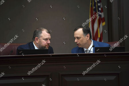 "State Sen. Rob Bradley, R-Fleming Island, left, and State Sen. Tom Lee, R-Brandon, right, during a Senate Rules Committee hearing regarding SB 404, known as the ""parental consent"" bill, at the Capitol, in Tallahassee, Fla. The bill requires girls under the age of 18 get a parent's consent before having an abortion was approved Wednesday in its final committee stop"