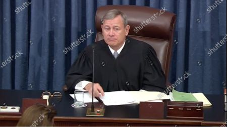 In this image from United States Senate television, Chief Justice of the United States John G Roberts Jnr, Jr. presides during the trial in the US Senate in the US Capitol