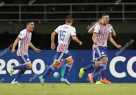Stock Photo of Paraguay's Sergio Bareiro, right, celebrates after scoring his side's first goal against Bolivia during a South America Olympic qualifying U23 soccer match at the Hernan Ramirez Villegas stadium in Pereira, Colombia