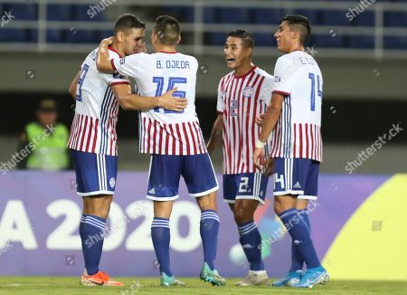 Paraguay's Sergio Bareiro, left, is congratulated by teammates Braian Ojeda, second left, Rodi Ferreira, second right, and Enzo Gimenez, right, after scoring his side's second goal against Bolivia during a South America Olympic qualifying U23 soccer match at the Hernan Ramirez Villegas stadium in Pereira, Colombia