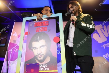 Juanes receives a gold record for his album 'Mas Futuro que Pasado' during a press conference in Bogota, Colombia, 22 January 2020.