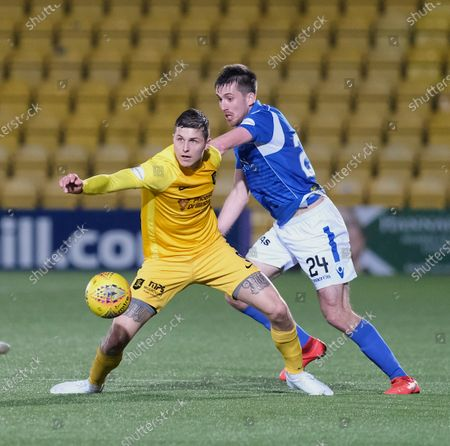 Lyndon Dykes of Livingston and Callum Booth of St Johnstone