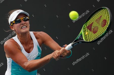 Australia's Arina Rodionova makes a backhand return to Kiki Bertens of the Netherlands during their second round singles match at the Australian Open tennis championship in Melbourne, Australia