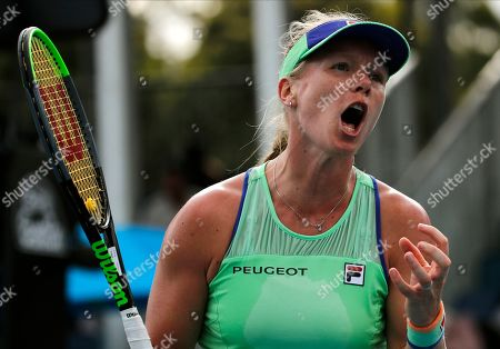 Kiki Bertens of the Netherlands reacts during her second round singles match against Australia's Arina Rodionova at the Australian Open tennis championship in Melbourne, Australia