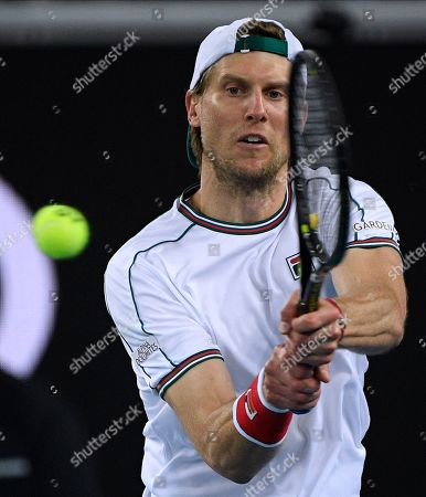 Italy's Andreas Seppi makes a backhand return to Switzerland's Stan Wawrinka during their second round singles match at the Australian Open tennis championship in Melbourne, Australia
