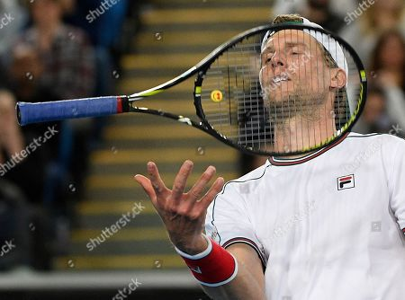 Italy's Andreas Seppi bounces his racket during his second round singles match against Switzerland's Stan Wawrinka at the Australian Open tennis championship in Melbourne, Australia