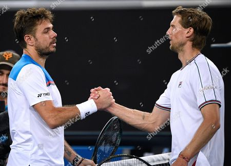 Switzerland's Stan Wawrinka, left, is congratulated by Italy's Andreas Seppi after winning their second round singles match at the Australian Open tennis championship in Melbourne, Australia