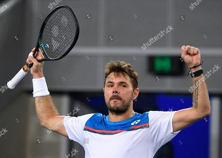 Switzerland's Stan Wawrinka celebrates after defeating Italy's Andreas Seppi in their second round singles match at the Australian Open tennis championship in Melbourne, Australia