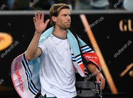Italy's Andreas Seppi waves as he leaves the court following his second round loss to Switzerland's Stan Wawrinka at the Australian Open tennis championship in Melbourne, Australia