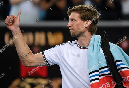 Italy's Andreas Seppi gestures as he leaves the court following his second round loss to Switzerland's Stan Wawrinka at the Australian Open tennis championship in Melbourne, Australia