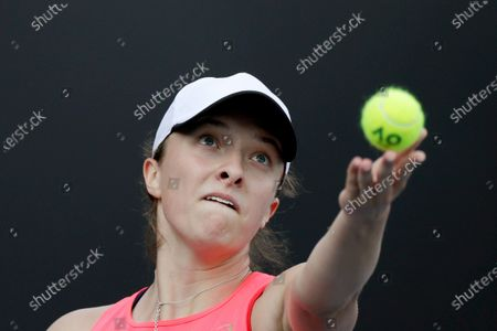 Iga Swiatek of Poland in action during her women's singles second round match against Carla Suarez Navarro of Spain at the Australian Open Grand Slam tennis tournament in Melbourne, Australia, 23 January 2020.