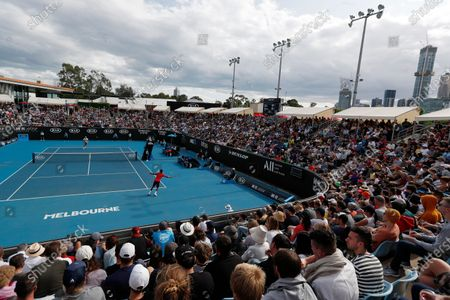 Stock Photo of Gael Monfils of France in action during his men's singles second round match against Ivo Karlovic of Croatia at the Australian Open Grand Slam tennis tournament in Melbourne, Australia, 23 January 2020.