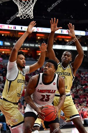Louisville center Steven Enoch (23) is defended by Georgia Tech guard Jordan Usher (1) and forward Moses Wright (5) during the second half of an NCAA college basketball game in Louisville, Ky., . Louisville won 68-64