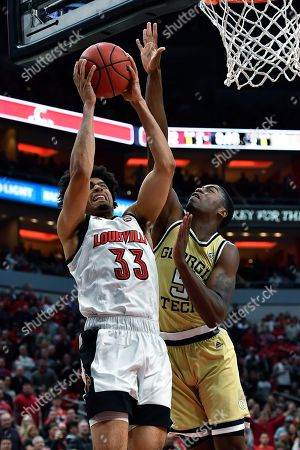 Georgia Tech forward Moses Wright (5) attempts to block the shot of Louisville forward Jordan Nwora (33) during the second half of an NCAA college basketball game in Louisville, Ky., . Louisville won 68-64