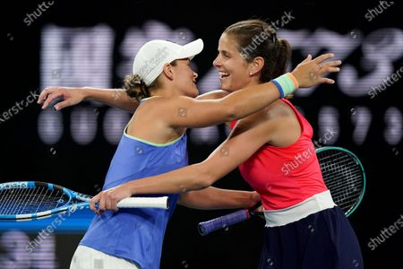 Ashleigh Barty of Australia (L) and Julia Goerges of Germany (R) in action during a first round doubles match against Astra Sharma of Australia and Jessica Moore of Australia on day four of the Australian Open tennis tournament at Melbourne Park in Melbourne, Australia, 23 January 2020.