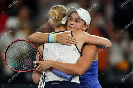 Ashleigh Barty of Australia (R)  hugs opponent Jessica Moore of Australia (L) during their first round doubles match on day four of the Australian Open tennis tournament at Melbourne Park in Melbourne, Australia, 23 January 2020.