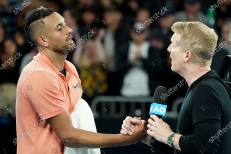 Stock Picture of Nick Kyrgios (L) of Australia is interviewd by former US tennis player Jim Courier after winning his second round match against Gilles Simon of France on day four of the Australian Open tennis tournament at Melbourne Arena in Melbourne, Australia, 23 January 2020.