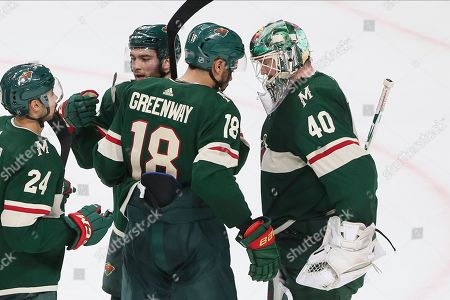 Devan Dubnyk, Jordan Greenway. Minnesota Wild's Devan Dubnyk, right, is congratulated by Jordan Greenway and others after the Wild defeated the Detroit Red Wings 4-2 in an NHL hockey game, in St. Paul, Minn. Greenway scored a goal in the first period