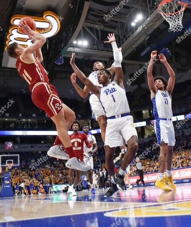 Stock Photo of Boston College's Derryck Thornton (11) shoots as Pittsburgh's Xavier Johnson (1),Au'Diese Toney (5), and Justin Champagnie (11) defend during the second half of an NCAA college basketball game, in Pittsburgh. Pittsburgh won 74-72