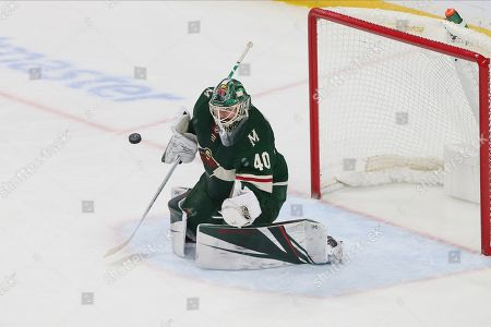 Minnesota Wild's Devan Dubnyk defends the net in an NHL hockey game against the Detroit Red Wings, in St. Paul, Minn