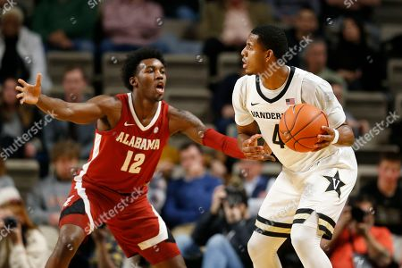 Vanderbilt guard Jordan Wright (4) is guarded by Alabama's Jaylen Forbes (12) in the first half of an NCAA college basketball game, in Nashville, Tenn
