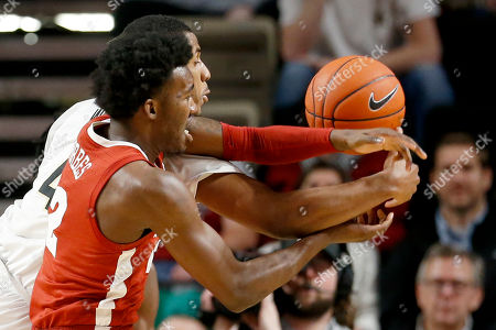 Alabama's Jaylen Forbes (12) and Vanderbilt's Jordan Wright (4) reach for the ball in the first half of an NCAA college basketball game, in Nashville, Tenn