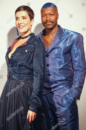Stock Photo of Cristina Cordula and Djibril Cisse backstage