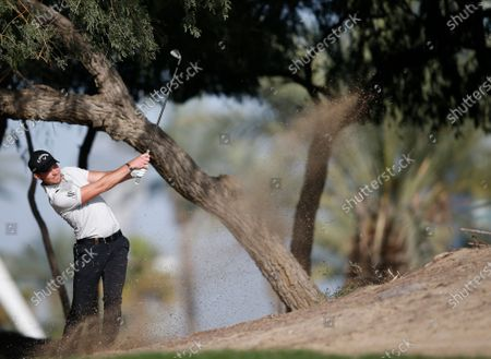 Danny Willet of England plays a shot from out of green during the first round of Omega Dubai Desert Classic 2020 Golf tournament at Emirates Golf Club in Dubai, United Arab Emirates, 23 January 2020.