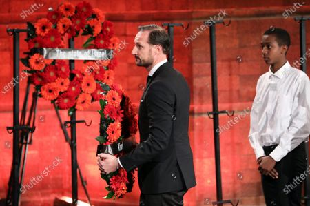 Crown Prince Haakon (C) of Norway lays a wreath during the Fifth World Holocaust Forum at the Yad Vashem Holocaust memorial museum in Jerusalem, Israel, 23 January 2020. The event marking the 75th anniversary of the liberation of Auschwitz under the title 'Remembering the Holocaust: Fighting Antisemitism' is held to preserve the memory of the Holocaust atrocities by Nazi Germany during World War II.