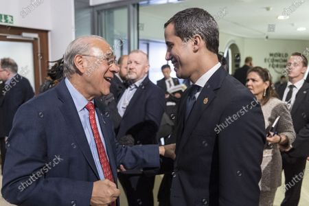 Angel Gurria (L), Secretary-General, Organisation for Economic Co-operation and Development (OECD), talks to Juan Guaido, President of the National Assembly of Venezuela, during the 50th annual meeting of the World Economic Forum (WEF) in Davos, Switzerland, 23 January 2020. The meeting brings together entrepreneurs, scientists, corporate and political leaders in Davos under the topic 'Stakeholders for a Cohesive and Sustainable World' from 21 to 24 January 2020.