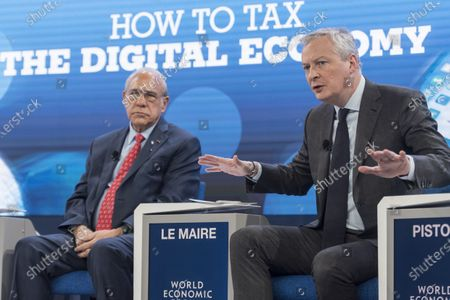 Bruno Le Maire (R), Minister of Economy and Finance of France, and Angel Gurria (L), Secretary-General, Organisation for Economic Co-operation and Development (OECD), take part in a panel session during the 50th annual meeting of the World Economic Forum (WEF) in Davos, Switzerland, 23 January 2020. The meeting brings together entrepreneurs, scientists, corporate and political leaders in Davos under the topic 'Stakeholders for a Cohesive and Sustainable World' from 21 to 24 January 2020.