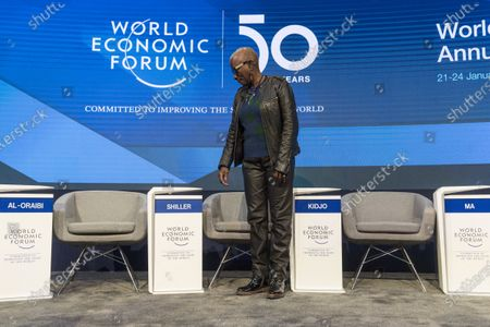 Angelique Kidjo, Musician and UNICEF Goodwill Ambassador, from Benin and France, searches her seat ahead of a panel session during the 50th annual meeting of the World Economic Forum (WEF) in Davos, Switzerland, 23 January 2020. The meeting brings together entrepreneurs, scientists, corporate and political leaders in Davos from January 21 to 24.